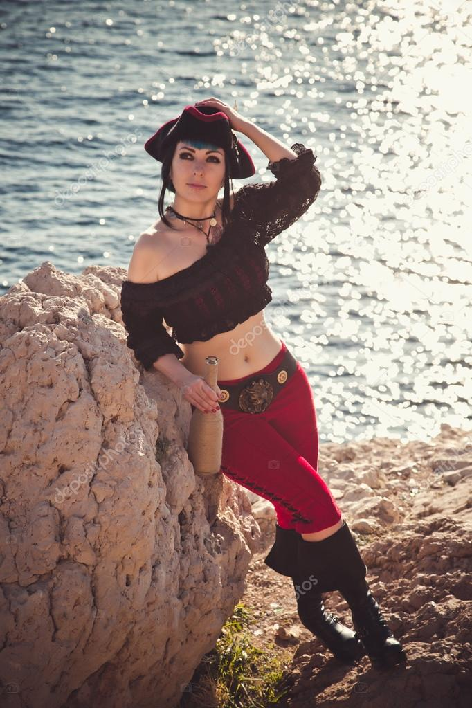 Portrait of a pirate woman at the beach