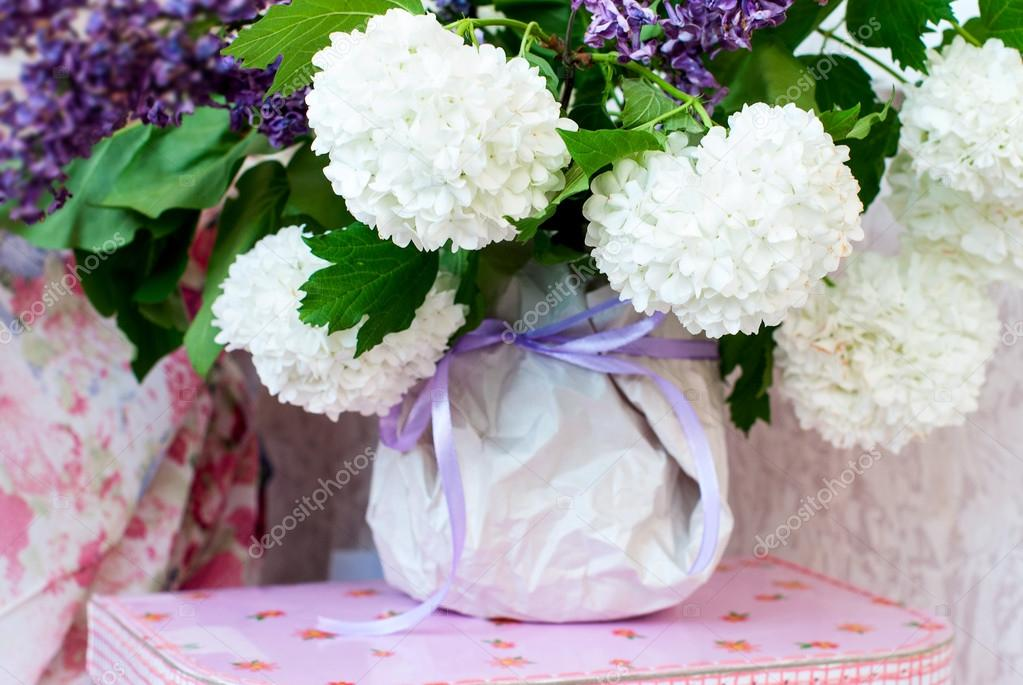 White lilacs in a vase