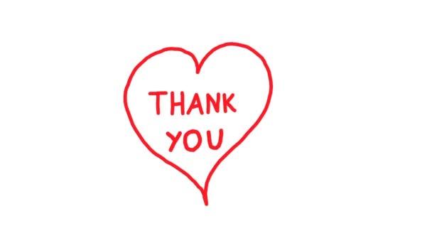 Danke von Herzen. Handgeschriebener roter Text in einem Herzen.
