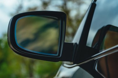 reflection in black elite car mirror