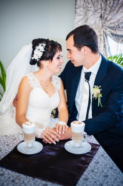 Love you honey.  Newly wed couple drinking cappuccino in cafe.