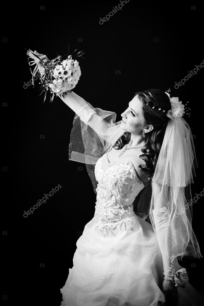Fashion Model With Bridal Bouquet Drinking Champagne And Wearing