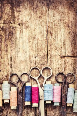 Scissors and bobbins with threads