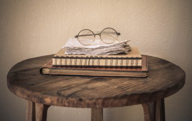 Bunch of books and retro glasses