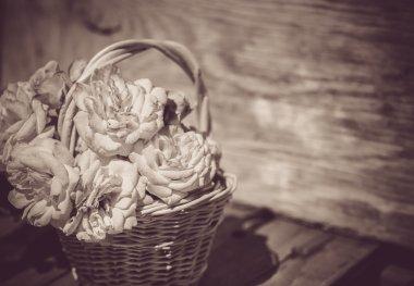 Dre roses in basket