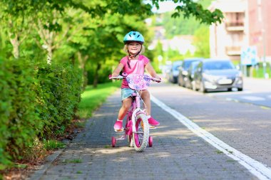 Little girl riding her bike