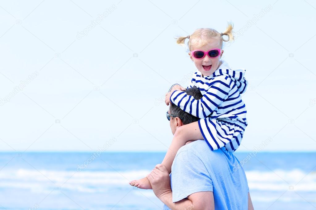 Father and daughter enjoying day together at the beach