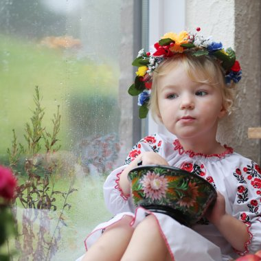 Cute Ukrainian girl eating from traditional plate