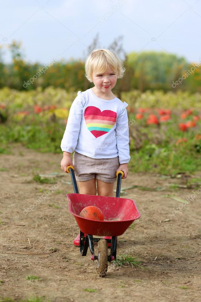 Little girl working in vegetables farm