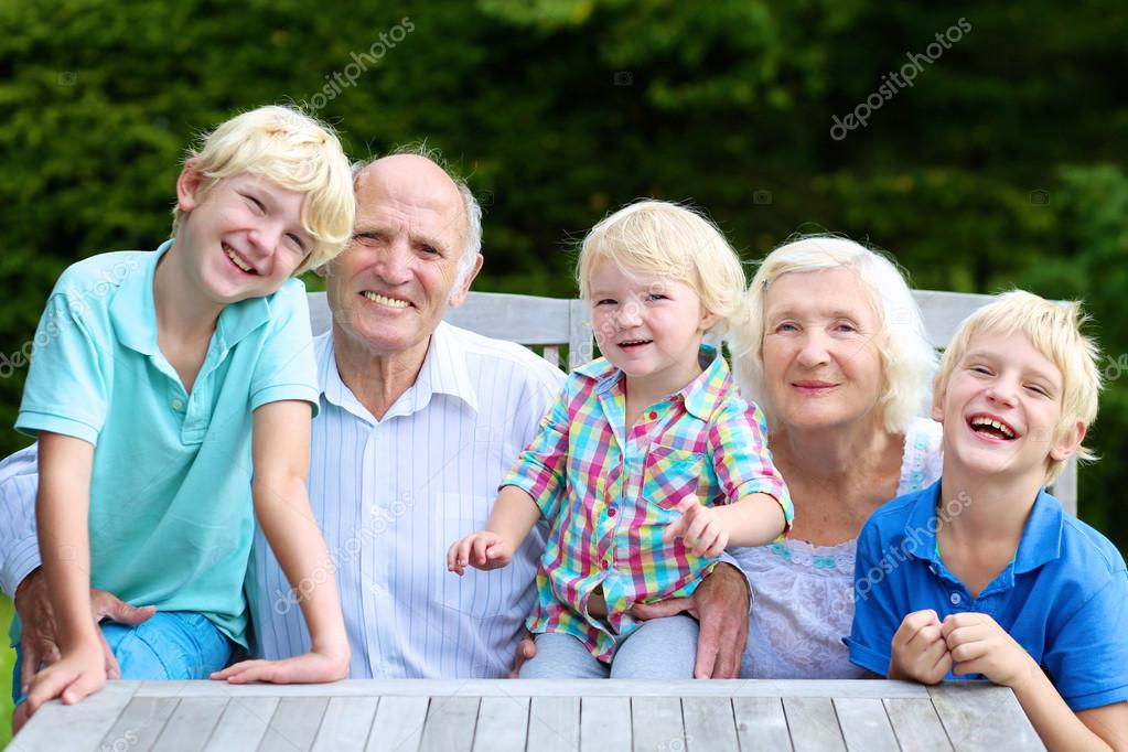 Grandparents with grandkids outdoors