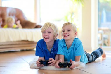 Two brothers playing video games at home