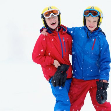 Two happy boys skiing in the Alps