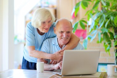 Modern senior couple relaxing at home