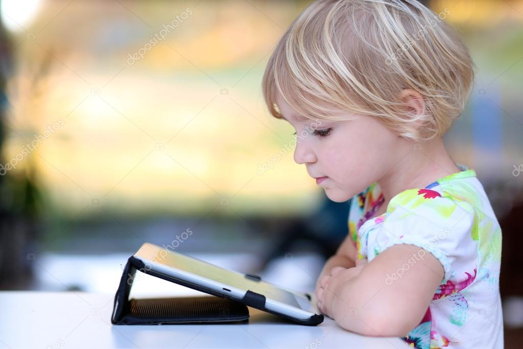 Preschooler girl playing with tablet pc