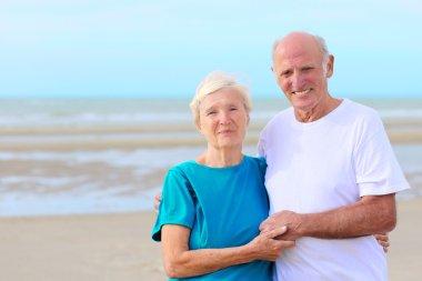Happy elders on the beach