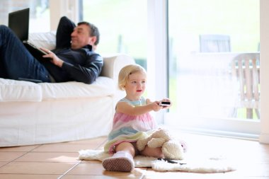 Father and daughter relaxing at home