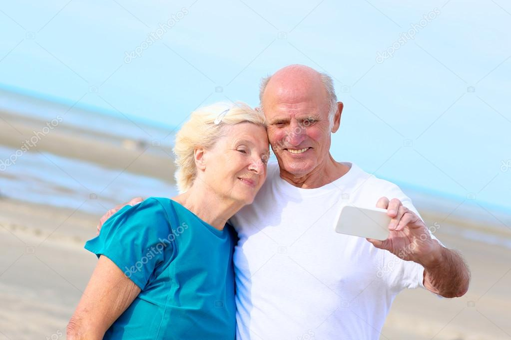 Happy elders on the beach
