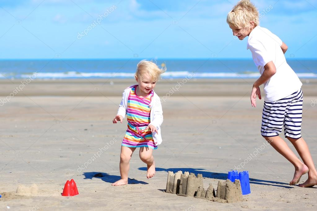 Happy kids playing on the beach