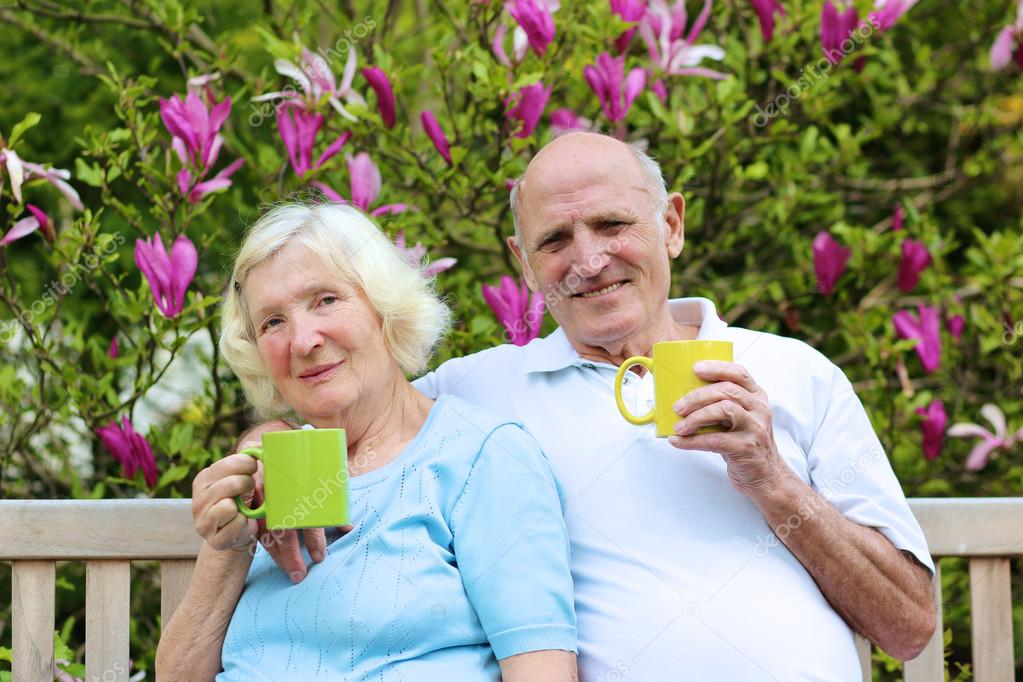 Senior couple drinking tea in the garden