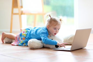 Little girl using laptop pc