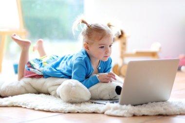 Little girl using laptop pc