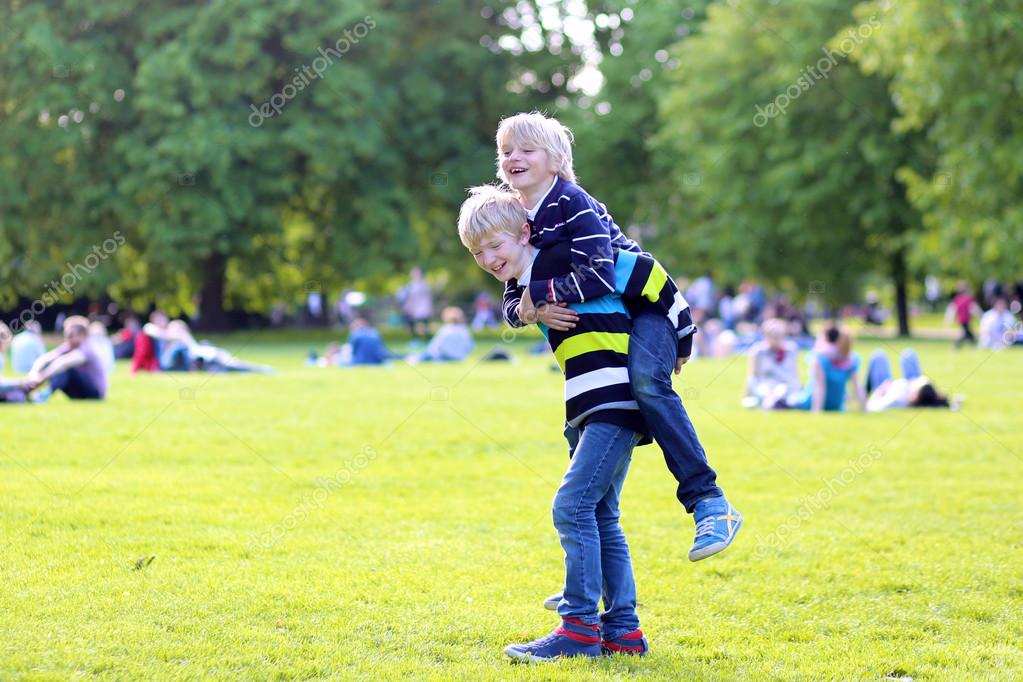 Two happy boys playing in the park