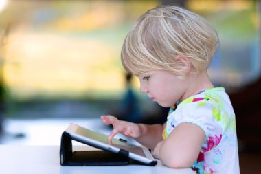 Preschooler girl using tablet pc