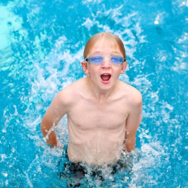 Active boy swimming in the pool