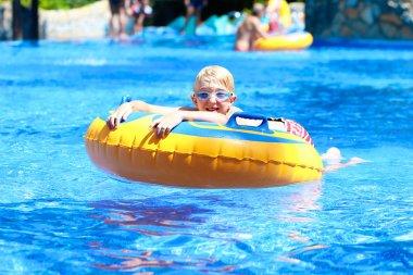Happy boy in water park