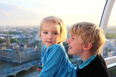 Brother and sister enjoying sightseeing in London