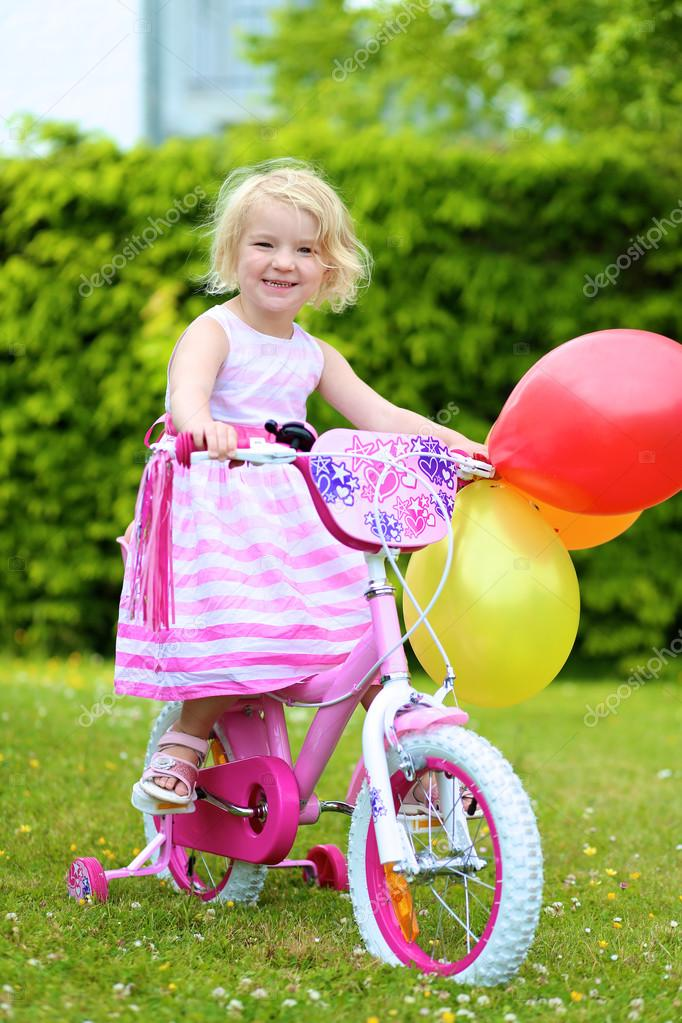 a89b7f39de2 Happy little girl riding her bicycle — Stock Photo © CroMary #79597540