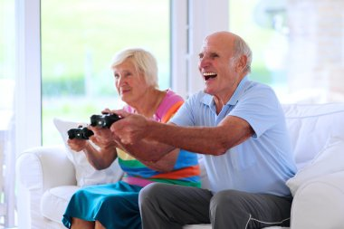 Senior couple having fun at home