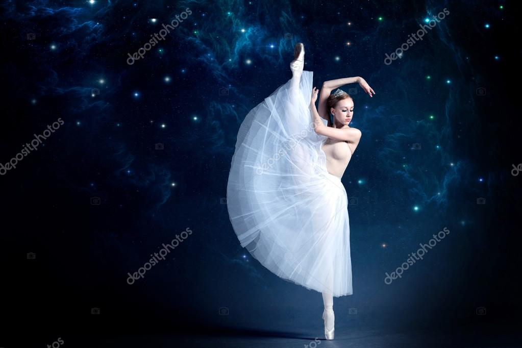 8528f7ca09a Young ballerina is dancing with the starry night sky in the background. —  Stock Photo