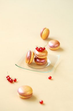 Colored Macarons with White Chocolate, Peach and Red Currant Filling