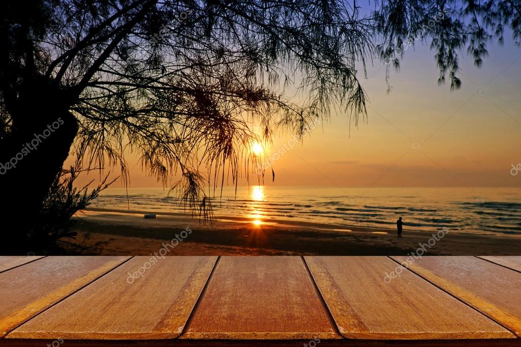 Outdoor Picnic Background with Wooden Table on Sea Pine Beach.