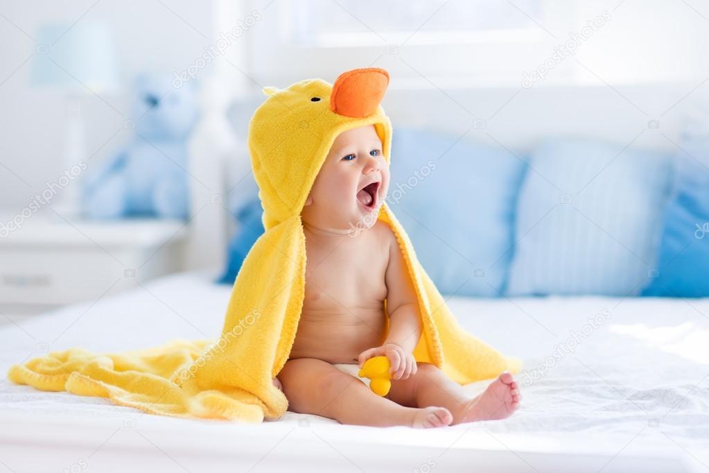 Cute baby after bath in yellow duck towel — Stock Photo © FamVeldman ...