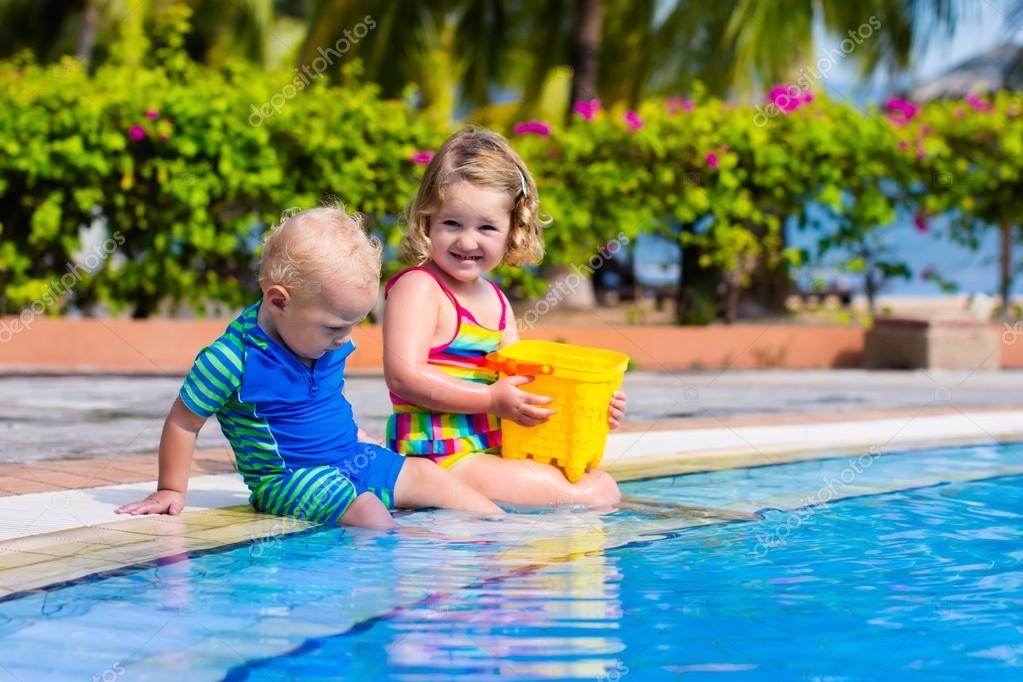 Little kids in swimming pool