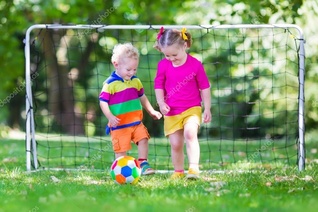 Kids playing football in school yard — Stock Photo ...