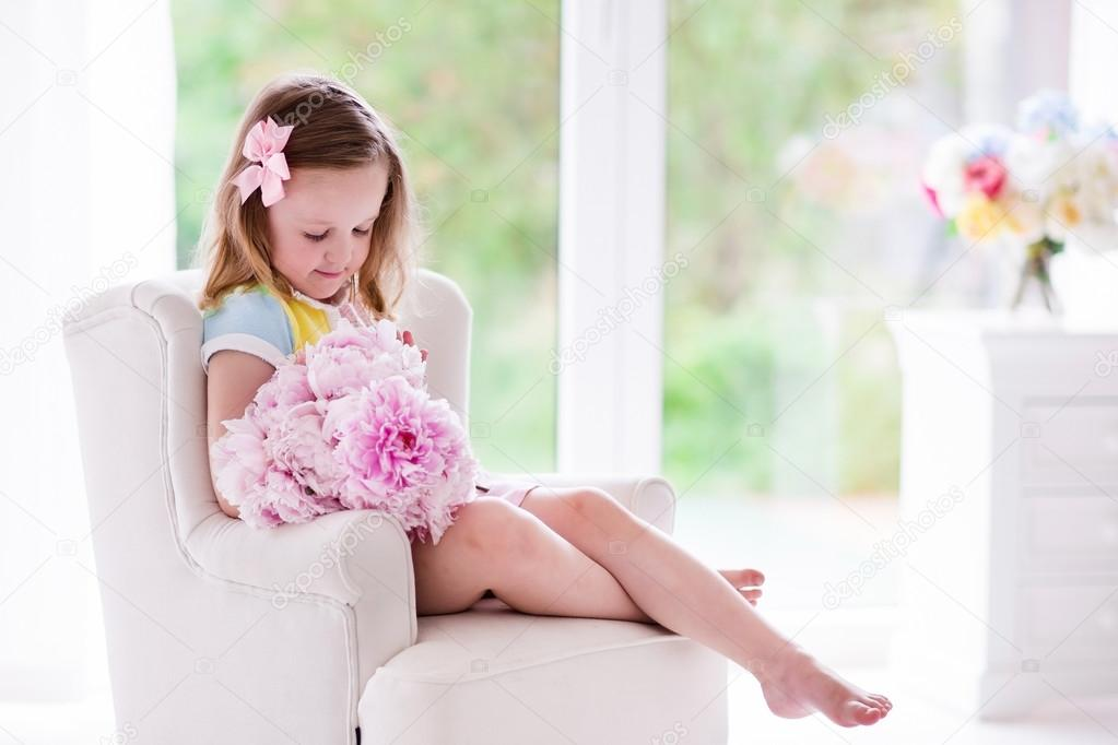 Little girl with peony flowers in white bedroom — Stock Photo ...