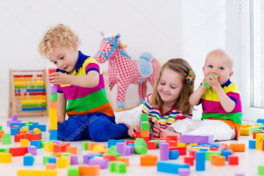 kids playing with colorful toy blocks � stock photo