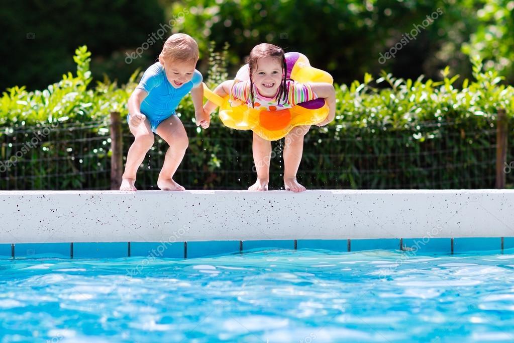 Kids Jumping Into Swimming Pool Stock Photo Famveldman