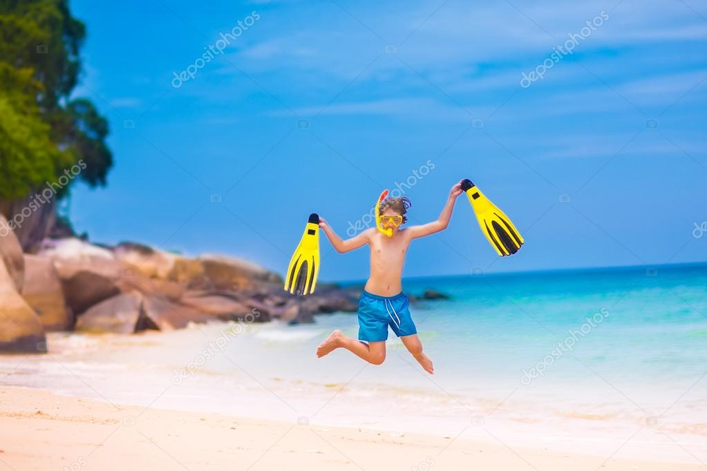 Boy jumping on a beach