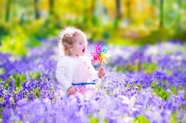 Little girl in a spring forest