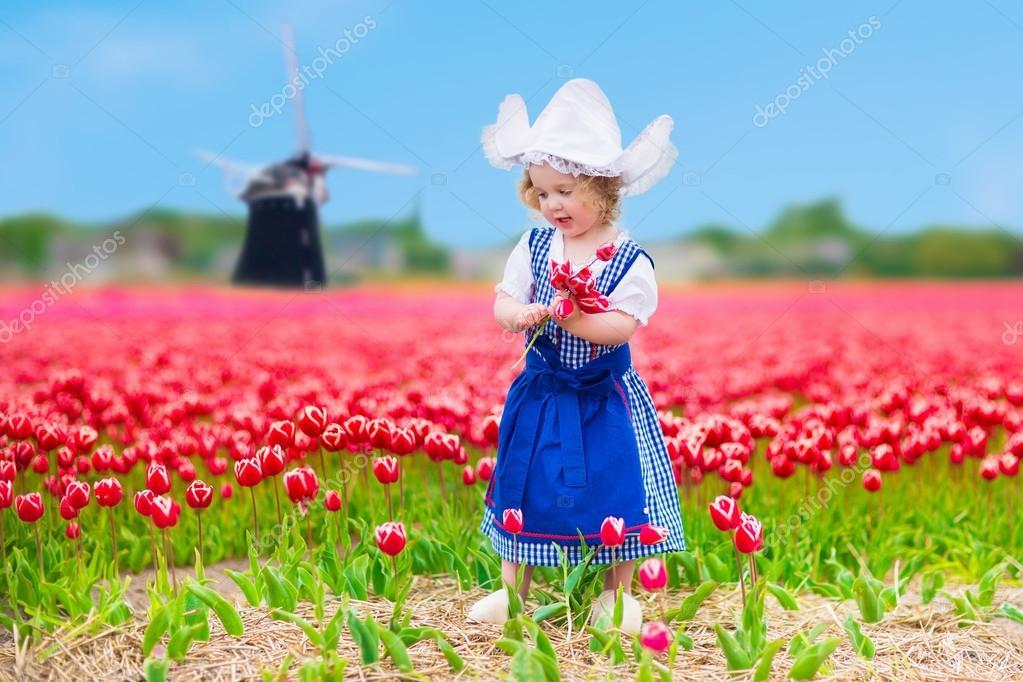 Dutch girl in tulip field in Holland