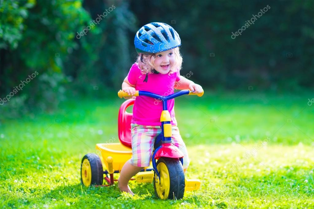Little girl on a bike