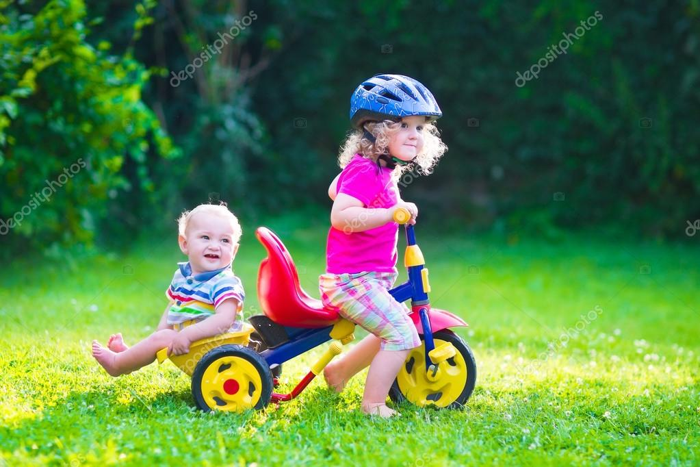 Two kids on a bike
