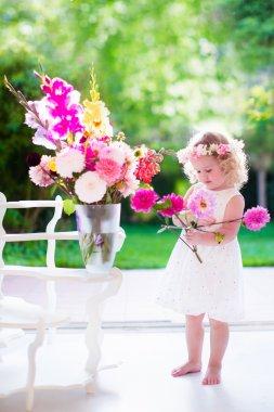 Little girl making flower arrangement