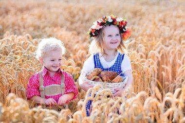 Kids in Bavarian costumes in wheat field