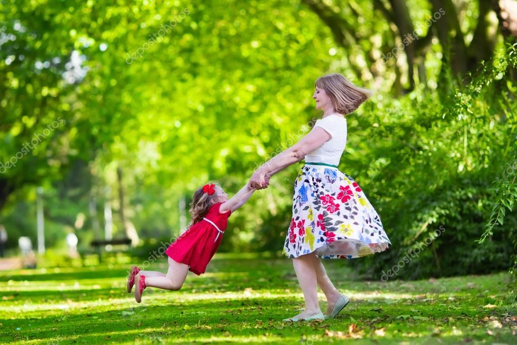 Mother and daughter playing in a park