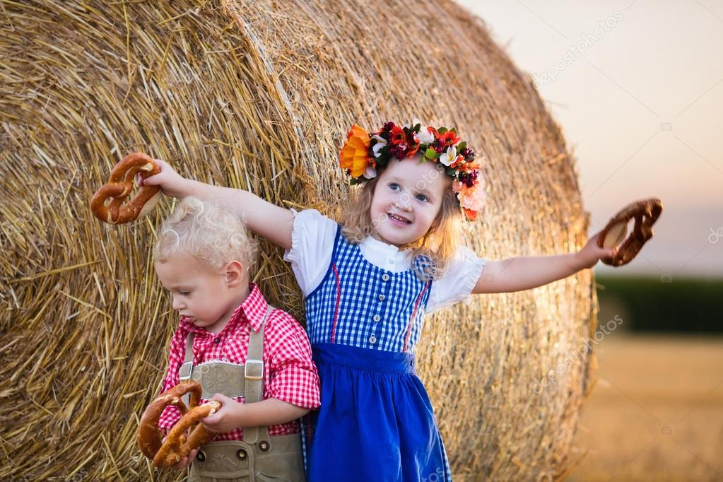 Kids playing in wheat field in Germany